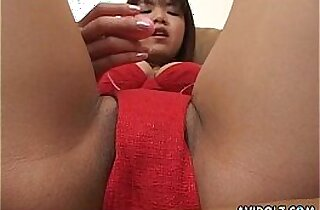 Asian bimbo is on her wet cunt masturbating her pussy with a toy